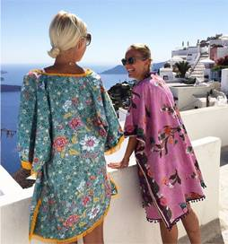 Santorini calling! Anna Skoog @annamavridis shows us how best to strut your @denizina_goddesswear kaftans! Exclusively at @ilovedesigner 15% off with 'Hello15' code Free international ship & returns.